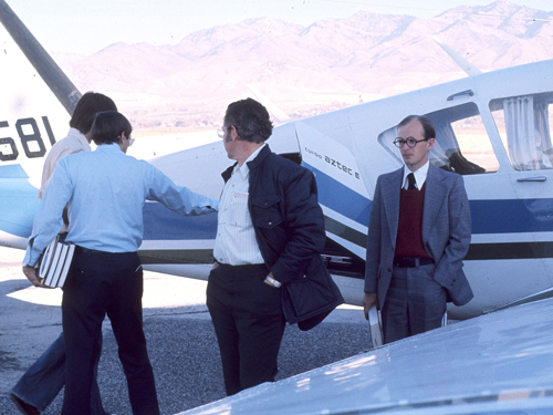 Professors traveling by plane